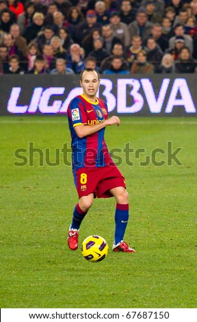 BARCELONA - DECEMBER 13: Nou Camp stadium, Spanish League match: FC Barcelona - Real Sociedad, 5 - 0. In the picture, Andres Iniesta in action. December 13, 2010 in Barcelona (Spain). - stock photo
