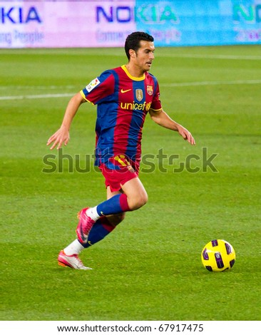 BARCELONA - DECEMBER 13: Nou Camp stadium, Spanish Soccer League: FC Barcelona - Real Sociedad, 5 - 0. In the picture, Pedro Rodriguez in action. December 13, 2010 in Barcelona (Spain). - stock photo