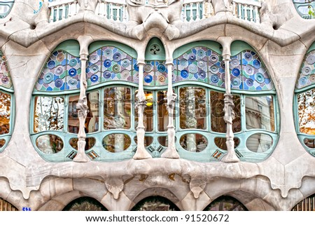 BARCELONA - DECEMBER 16: The facade of the house Casa Battlo (also could the house of bones) designed by Antoni Gaudi with his famous expressionistic style on December 16, 2011 Barcelona, Spain - stock photo