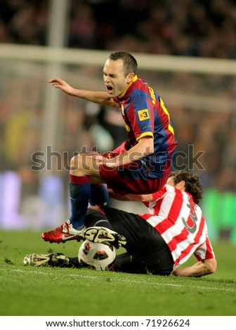 BARCELONA - FEB 20: Andres Iniesta of Barcelona in action during the match between FC Barcelona and Athletic de Bilbao at the Nou Camp Stadium on February 20, 2011 in Barcelona, Spain - stock photo