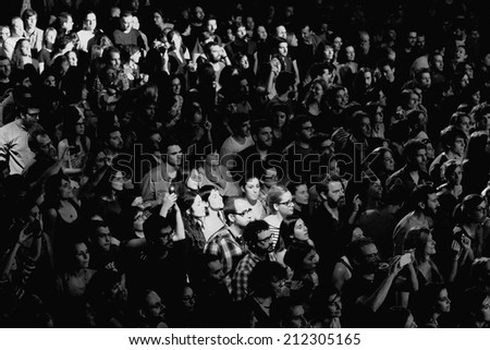BARCELONA - FEB 15: Black and white picture of the crowd at Razzmatazz Clubs on February 15, 2014 in Barcelona, Spain.
