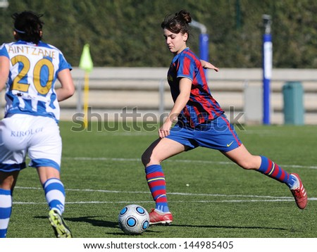 BARCELONA - FEB 7: F.C Barcelona women's football team players play against Real Sociedad on February 7, 2010 in Barcelona, Spain. Superliga (Femenine Spanish League) match.
