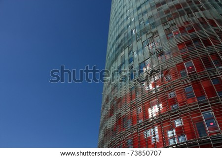 BARCELONA- FEB 2: Facade of Agbar Tower on Feb 2, 2010 in Barcelona, Spain. The Torre Agbar is a new skyscraper in a conical shape, which has become a new symbol of the city of Barcelona, Spain - stock photo