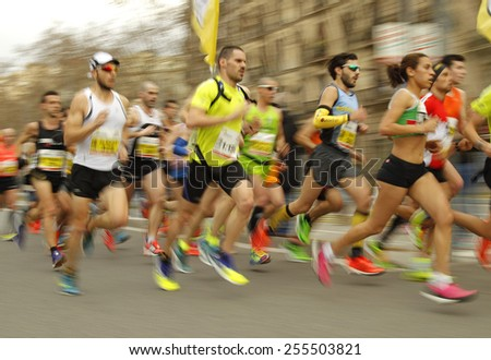 BARCELONA - FEB, 15: Group of runners in Barcelona streets running during Barcelona Half Marathon in Barcelona on February 15, 2015 in Barcelona, Spain. - stock photo