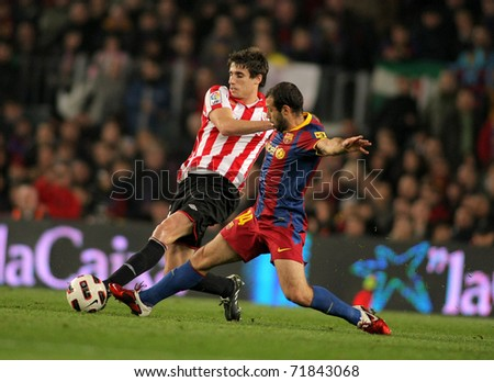 BARCELONA - FEB 20: Javi Martinez(L) of  Bilbao fight with Mascherano(R) of Barcelona during  the match between FC Barcelona and Bilbao at the Nou Camp Stadium on February 20, 2011 in Barcelona, Spain - stock photo