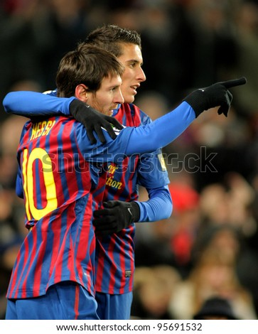 BARCELONA - FEB 4: Leo Messi with Cristian Tello of FC Barcelona celebrate goal during spanish league match against Real Sociedad at the Camp Nou stadium on February 4, 2012 in Barcelona, Spain - stock photo