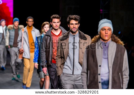 BARCELONA - FEB 5: Male models walk the runway for the Torras collection at the 080 Barcelona Fashion Week 2015 Fall Winter on February 5, 2015 in Barcelona, Spain. - stock photo