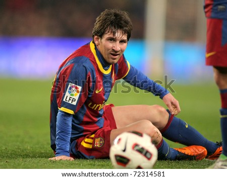 BARCELONA - FEB 20: Messi of Barcelona fallen to the ground during the match between FC Barcelona and Athletic de Bilbao at the Nou Camp Stadium on February 20, 2011 in Barcelona, Spain - stock photo