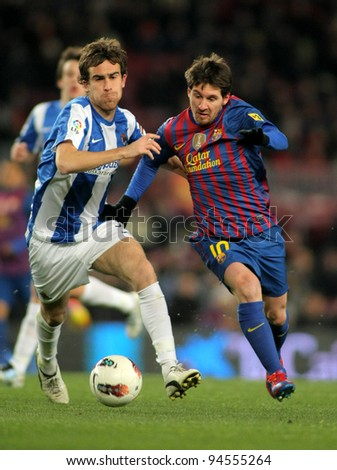 BARCELONA - FEB, 4: Mikel Gonzalez(L) of Real Sociedad vies with Leo Messi(R) of FC Barcelona during the Spanish league match at the Camp Nou stadium on February 4, 2012 in Barcelona, Spain - stock photo