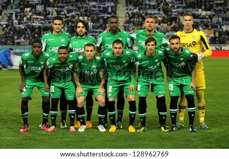 BARCELONA - FEB, 17: Real Betis team posing before the Spanish League match between Espanyol and Betis at the Estadi Cornella on February 17, 2013 in Barcelona, Spain - stock photo