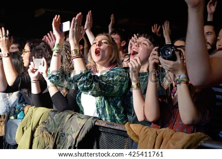 BARCELONA - FEB 6: The crowd cheering in a concert at Razzmatazz stage on February 6, 2016 in Barcelona, Spain. - stock photo