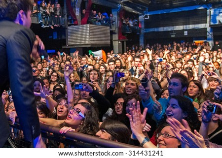 BARCELONA - FEB 12: The singer of The Script (band) performs with the crowd at Razzmatazz discotheque on February 12, 2011 in Barcelona, Spain. - stock photo