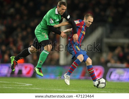 BARCELONA - FEB 20: Xisco (L) of Santander and Iniesta (R) of Barcelona during Spanish league match between Barcelona and Santander at the Nou Camp Stadium on February 20, 2010 in Barcelona, Spain.