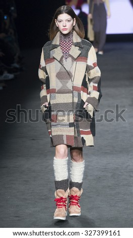 BARCELONA - FEBRUARY 05: a model walks on the Aldomartins catwalk during the 080 Barcelona Fashion runway Fall/Winter 2015 on February 05, 2015 in Barcelona, Spain.  - stock photo
