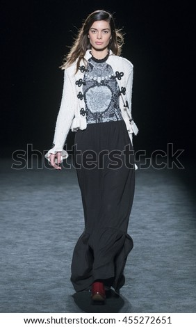BARCELONA - FEBRUARY 04: a model walks on the Aldomartins catwalk during the 080 Barcelona Fashion runway Fall/Winter 2016 on February 04, 2016 in Barcelona, Spain.  - stock photo