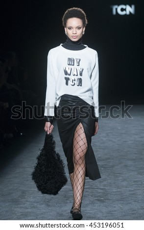 BARCELONA - FEBRUARY 01: a model walks on the TCN catwalk during the 080 Barcelona Fashion runway Fall/Winter 2016 on February 01, 2016 in Barcelona, Spain.  - stock photo