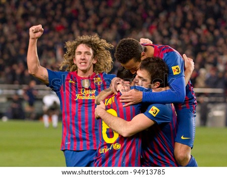 BARCELONA - FEBRUARY 2: Barcelona players celebrate a goal during the Spanish Cup match between FC Barcelona and Valencia, final score 2-0, on February 2, 2012, in Camp Nou stadium, Barcelona, Spain. - stock photo