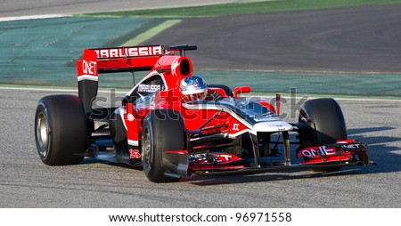 BARCELONA - FEBRUARY 21: Charles Pic of Marussia F1 team races during Formula One Teams Test Days at Catalunya circuit on February 21, 2012 in Barcelona, Spain. - stock photo