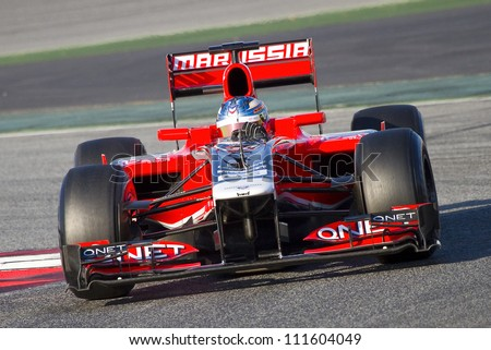 BARCELONA - FEBRUARY 21: Charles Pic of Marussia F1 team racing at Formula One Teams Test Days at Catalunya circuit on February 21, 2012 in Barcelona, Spain. - stock photo