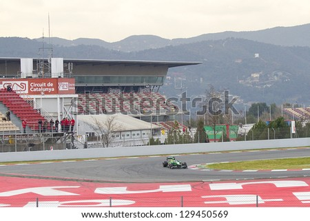 BARCELONA - FEBRUARY 19: Charles Pic racing with his new Caterham CT03 at Formula One Teams Test Days at Catalunya circuit on February 19, 2013 in Montmelo, Barcelona, Spain. - stock photo