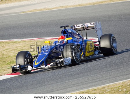 BARCELONA - FEBRUARY 22: Felipe Nasr racing with his Sauber at Formula One Test Days at Catalunya circuit, on February 22, 2015, in Barcelona, Spain. - stock photo