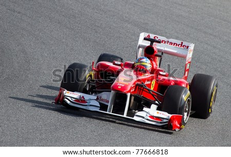 BARCELONA - FEBRUARY 18: Fernando Alonso (Ferrari) driving his F1 car during Formula One Teams Test Days at Catalunya circuit, on February 18, 2011 in Barcelona, Spain.
