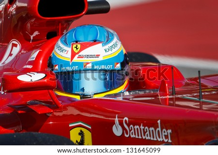 BARCELONA - FEBRUARY 20: Fernando Alonso of Ferrari F1 team in cockpit of his Ferrari at Formula One Test Days at Catalunya circuit on February 20, 2013 in Barcelona, Spain. - stock photo