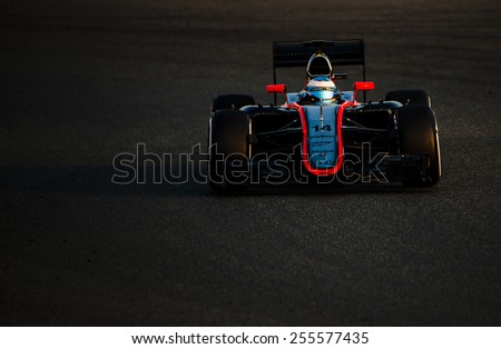 BARCELONA - FEBRUARY 20: Fernando Alonso of McLaren Honda at second day of Formula One Test Days at Catalunya Circuit on February 20, 2015 in Barcelona, Spain. - stock photo