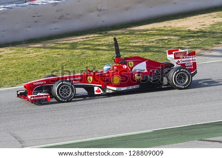 BARCELONA - FEBRUARY 19: Fernando Alonso racing with his new Ferrari F138 at Formula One Teams Test Days at Catalunya circuit on February 19, 2013 in Montmelo, Barcelona, Spain.