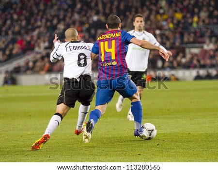 BARCELONA - FEBRUARY 2: Javier Mascherano (14) in action during the Spanish Cup match between FC Barcelona and Valencia CF, final score 2-0, on February 2, 2012, in Camp Nou stadium, Barcelona, Spain. - stock photo
