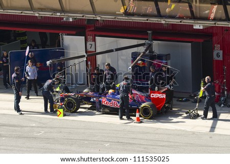 BARCELONA - FEBRUARY 24: Jean Eric Vergne of Toro Rosso F1 team in the pit during Formula One Teams Test Days at Catalunya circuit on February 24, 2012 in Barcelona, Spain. - stock photo