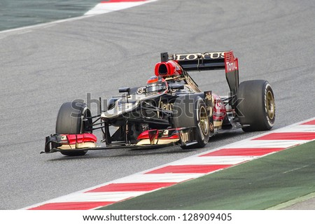 BARCELONA - FEBRUARY 19: Kimi Raikkonen racing with his new Lotus Renault E21 at Formula One Teams Test Days at Catalunya circuit on February 19, 2013 in Montmelo, Barcelona, Spain. - stock photo