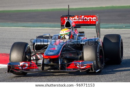 BARCELONA - FEBRUARY 21: Lewis Hamilton of McLaren F1 team races during Formula One Teams Test Days at Catalunya circuit on February 21, 2012 in Barcelona, Spain. - stock photo