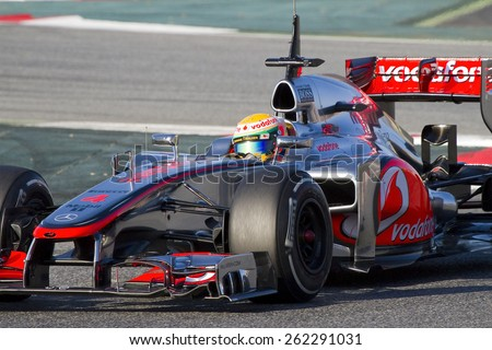 BARCELONA - FEBRUARY 21: Lewis Hamilton of McLaren F1 team racing at Formula One Teams Test Days at Catalunya circuit on February 21, 2012 in Barcelona, Spain. - stock photo
