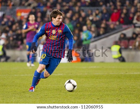 BARCELONA - FEBRUARY 2: Lionel Messi in action during the Spanish Cup match between FC Barcelona and Valencia CF, final score 2-0, on February 2, 2012, in Camp Nou stadium, Barcelona, Spain. - stock photo
