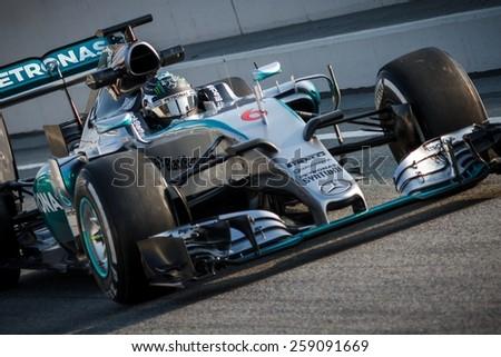 BARCELONA - FEBRUARY 20: Nico Rosberg of Mercedes AMG Petronas F1 team at Formula One Test Days at Catalunya circuit on February 20, 2015 in Barcelona, Spain. - stock photo