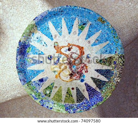 BARCELONA - FEBRUARY 18: Park guell  in Barcelona with mosaic medallions on the ceiling of the terrace.The vibrant colors of the tiles are breathtaking on February 18, 2011 in Barcelona, Spain - stock photo
