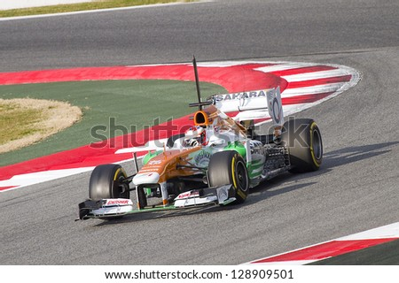 BARCELONA - FEBRUARY 19: Paul Di Resta racing with his new Force India  VJM06 at Formula One Teams Test Days at Catalunya circuit on February 19, 2013 in Montmelo, Barcelona, Spain. - stock photo