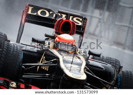 BARCELONA - FEBRUARY 28: Romain Grosjean of Lotus F1 team during Formula One Test Days at Catalunya circuit on February 28, 2013 in Barcelona, Spain. - stock photo
