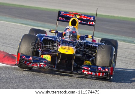 BARCELONA - FEBRUARY 21: Sebastian Vettel of Red Bull F1 team racing at Formula One Teams Test Days at Catalunya circuit on February 21, 2012 in Barcelona, Spain. - stock photo