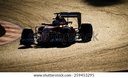 BARCELONA - FEBRUARY 27: Sebastian Vettel of Scuderia Ferrari F1 team at Formula One Test Days at Catalunya circuit on February 27, 2015 in Barcelona, Spain. - stock photo