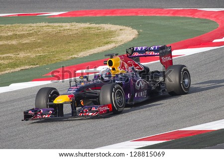 BARCELONA - FEBRUARY 19: Sebastian Vettel racing with his new Red Bull RB9 at Formula One Teams Test Days at Catalunya circuit on February 19, 2013 in Montmelo, Barcelona, Spain. - stock photo