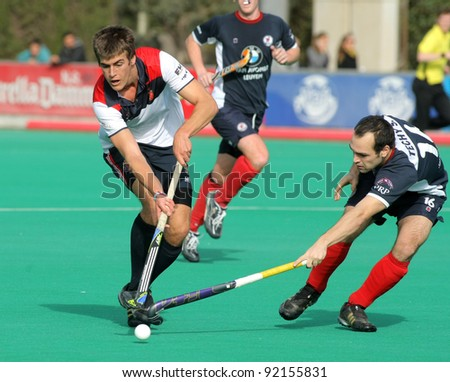 BARCELONA - JAN 6: Alex Casasayas(L) of RC Polo vies with Sebastien Techy(R) of KHC Leuven during a King's Trophy match at the RC de Polo pitch on January 6, 2012 in Barcelona, Spain