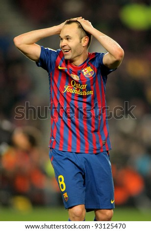 BARCELONA - JAN 15: Andres Iniesta of FC Barcelona reacts during the Spanish league match between FC Barcelona and Real Betis at the Camp Nou stadium on January 15, 2012 in Barcelona, Spain - stock photo