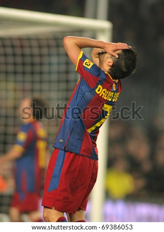 BARCELONA - JAN 12: David Villa of Barcelona in action during the match between FC Barcelona and Real Betis at the Nou Camp Stadium on January 12, 2011 in Barcelona, Spain - stock photo