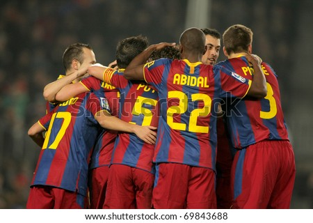 BARCELONA - JAN 16: FC Barcelona players huddle during a match between FC Barcelona and Malaga CF at the Nou Camp Stadium on January 16, 2011 in Barcelona, Spain