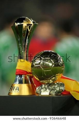 BARCELONA - JAN, 15: FIFA Club World Cup trophy won for FC Barcelona and Golden ball won for Leo Messi before the Spanish league match at the Camp Nou stadium on January 15, 2012 in Barcelona, Spain - stock photo