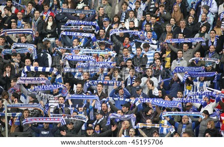 BARCELONA - JAN 24: Group of supporters of Espanyol during the Spanish League match against Mallorca at the Estadi Cornella on January 24, 2010 in Barcelona, Spain - stock photo