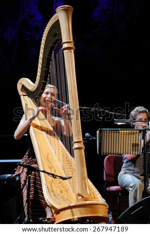 BARCELONA - JAN 20: Joanna Newsom (harp player and singer) performs at Palau de la Musica on January 20, 2011 in Barcelona, Spain. - stock photo
