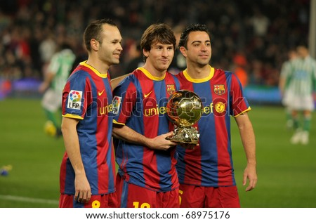 BARCELONA - JAN 12: (L-R) Iniesta, Messi and Xavi of Barcelona with golden ball before a Spanish Cup match between FC Barcelona and Real Betis at the Nou Camp Stadium on January 12, 2011 in Barcelona, Spain - stock photo